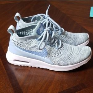 Good used condition. Nike thea flyknit light blue